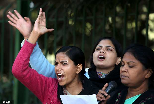 Indian women activists shout slogans demanding safety for women as they stage a protest Tuesday, Dec.18, 2012, condemning the gang rape of a 23-year-old student on a city bus late Sunday in New Delhi, India. The Indian parliament Tuesday witnessed outrage over the issue even as the victim is battling for her life at a city hospital. (AP Photo/Manish Swarup)