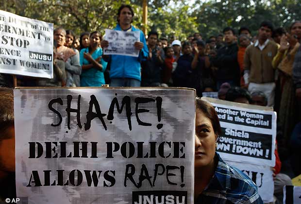 An Indian woman along with the others participates in a protest condemning the gang rape of a 23-year-old student on a city bus late Sunday in New Delhi, India, Tuesday, Dec. 18, 2012. The Indian parliament Tuesday witnessed outrage over the issue even as the victim is battling for her life at a city hospital. (AP Photo/Tsering Topgyal)