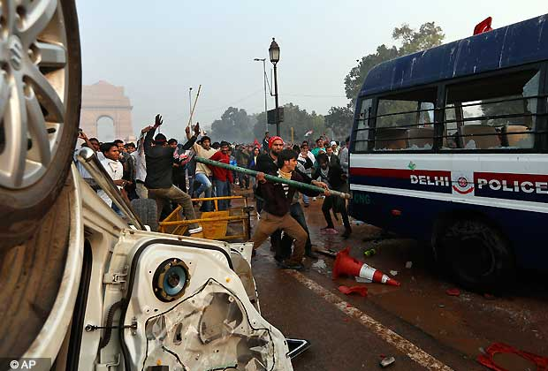 Indian protesters destroy a police van during a violent demonstration near the India Gate against a gang rape and brutal beating of a 23-year-old student on a bus last week, in New Delhi, India, Sunday, Dec. 23, 2012. The attack last Sunday has sparked days of protests across the country. (AP Photo/ Saurabh Das)
