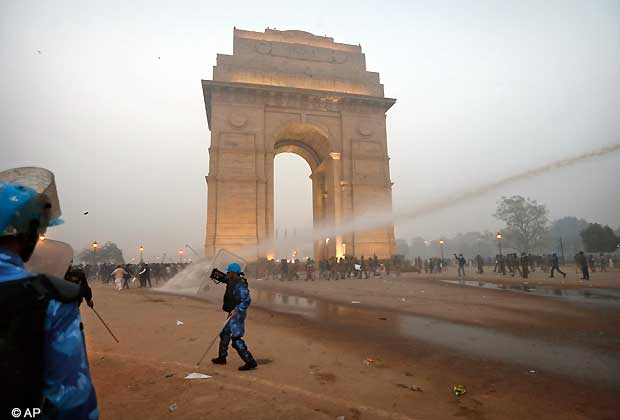 Indian police officers use water canon to clear the area during a violent demonstration near the India Gate against a gang rape and brutal beating of a 23-year-old student on a bus last week, in New Delhi, India, Sunday, Dec. 23, 2012. The attack last Sunday has sparked days of protests across the country. (AP Photo/ Saurabh Das)