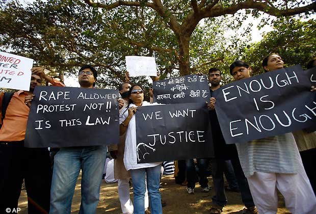 Indians hold placards during a gathering to mourn the death of a 23-year-old gang rape victim, in Mumbai, India, Saturday, Dec. 29, 2012. (AP Photo/Rafiq Maqbool)