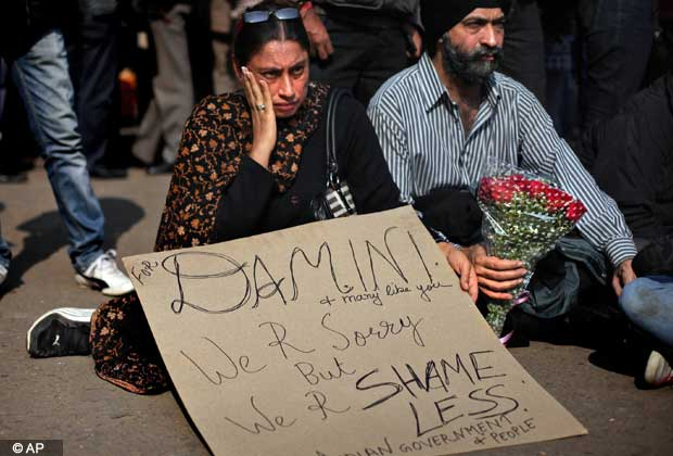 Indians attend a gathering to mourn the death of a rape victim in New Delhi, India, Saturday, Dec. 29, 2012.(AP Photo/Altaf Qadri).