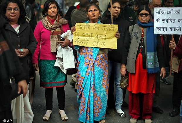 Indian women gather to mourn the death of a gang rape victim in New Delhi, India, Saturday, Dec. 29, 2012. Shocked Indians on Saturday were mourning the death of the woman who was gang-raped and beaten on a bus in New Delhi nearly two weeks ago in an ordeal that galvanized people to demand greater protection for women from sexual violence. (AP Photo/Altaf Qadri)