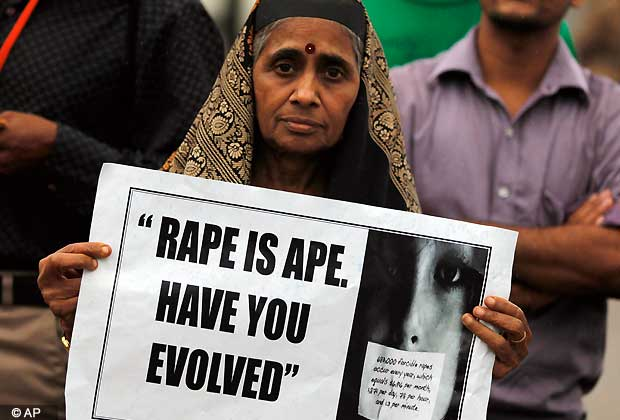 An Indian woman holds a placard during a protest to mourn the death of a gang rape victim, in Bangalore, India , Saturday, Dec. 29, 2012. (AP Photo/Aijaz Rahi)