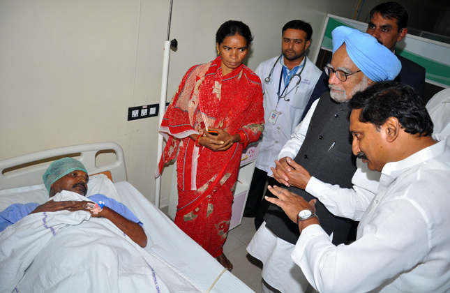 Prime MInister Manmohan Singh accompanied by Andhra Pradesh Chief MInister N.Kiran Kumar Reddy is seen consoling the victims of bomb blast at Yashoda Hospital in Hyderabad on Feb. 24, 2013. Sri ESL Narasimhan,H.E. Governor of AP., Smt.P.Sabitha Reddy, Minister for Home and other Dignitaries are also seen. (Photo: IANS)